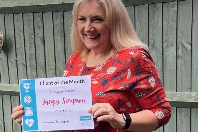 Jacqui with her Client of the Month certificate